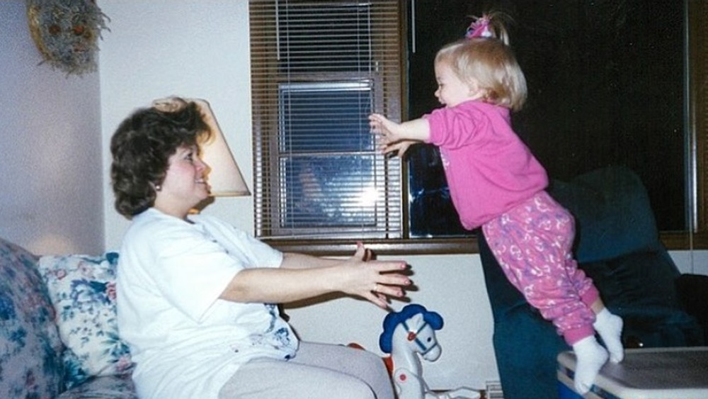 Young Shawn Johnson jumping into her mom's arms