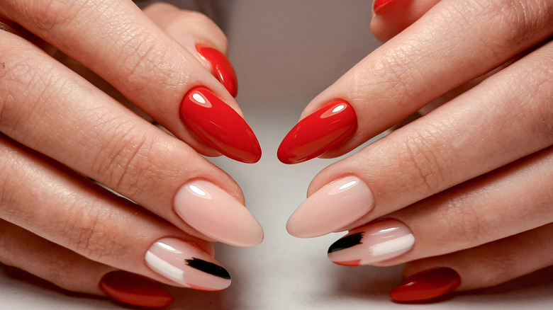 Manicured almond nails with design