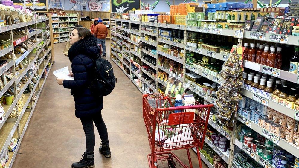 woman shopping inside Trader Joe's