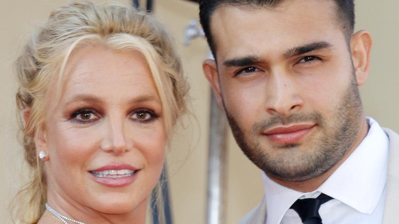 Britney Spears and Sam Asghari smiling