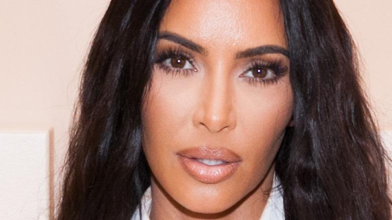 Kim Kardashian poses on the red carpet
