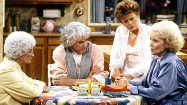 The Golden Girls around the table.
