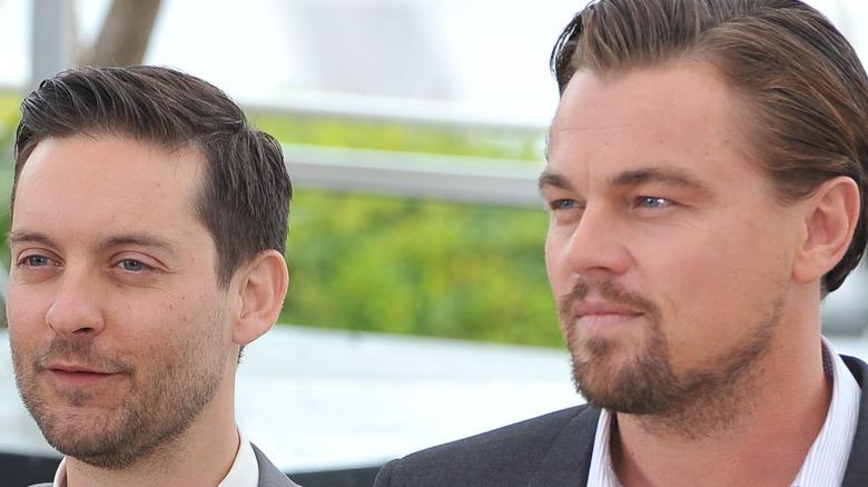 Leonardo DiCaprio and Tobey Maguire standing