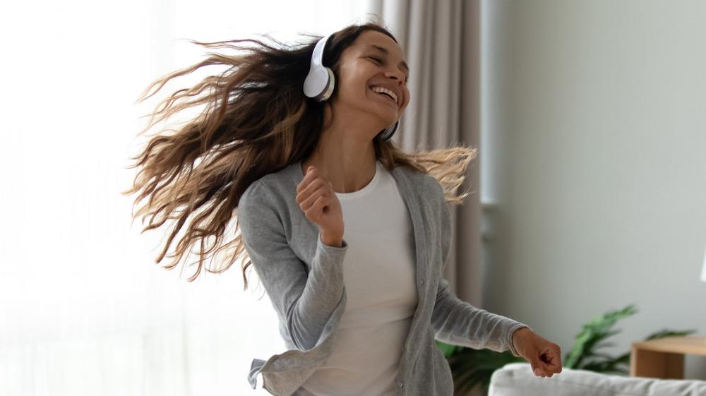 Woman dancing in her living room