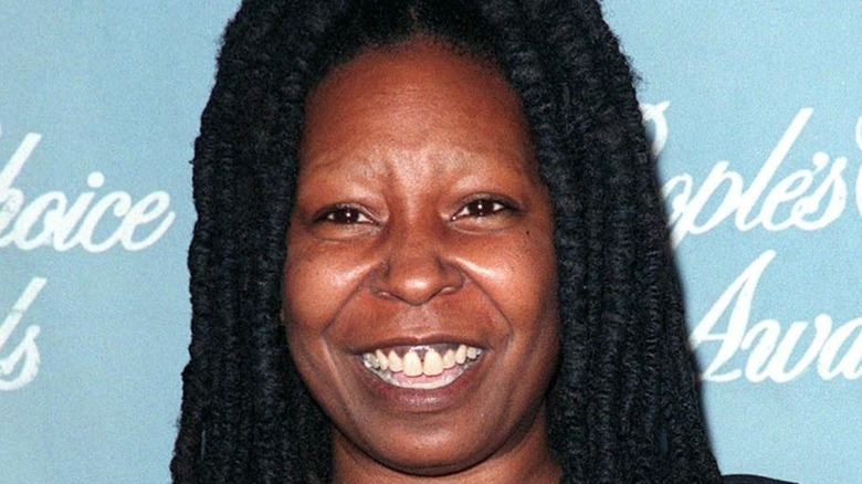 Whoopi Goldberg smiles