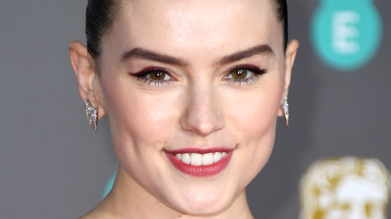 Daisy Ridley smiling with hair back