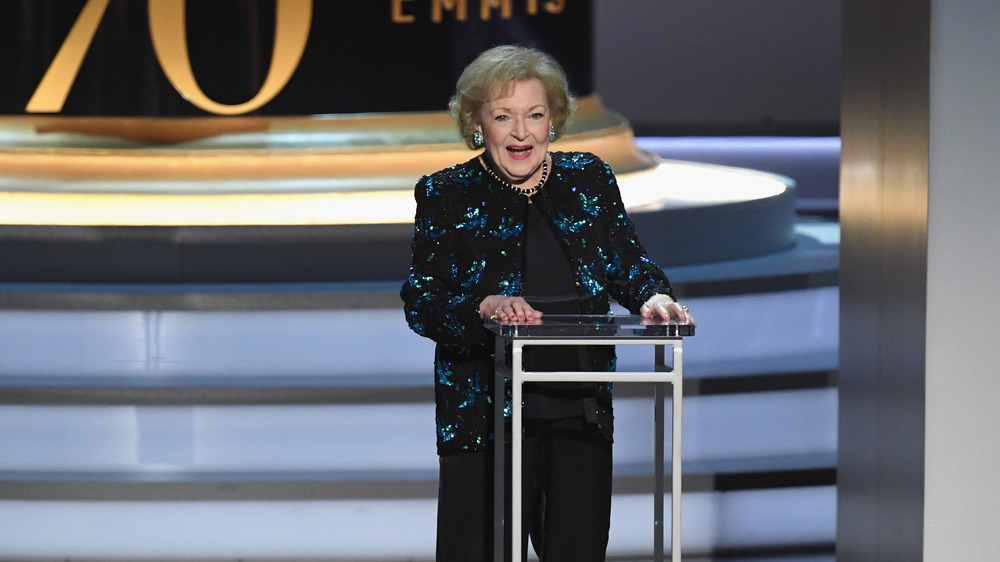 Betty White on the stage at the podium