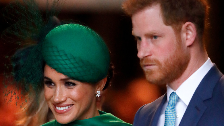 Harry and Meghan smiling