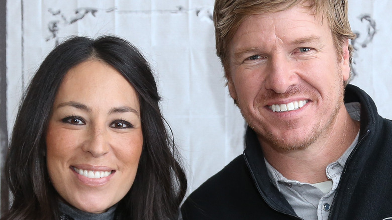 Joanna and Chip Gaines snuggle up at an event