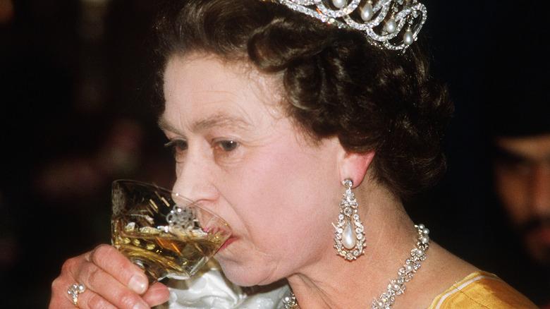 Queen Elizabeth drinking in the 80s