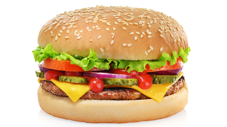 Cheeseburger prepared by a food stylist with an isolate white background