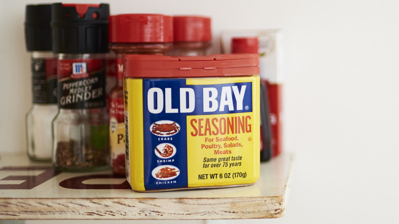 Old Bay Seasoning on shelf with other spices