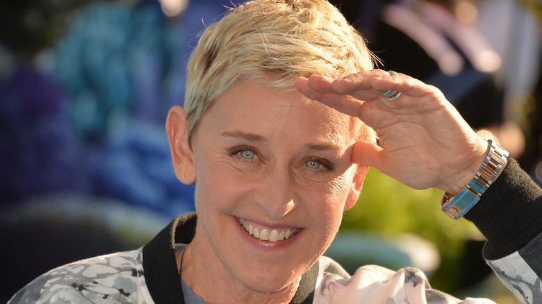 Ellen DeGeneres shields her eyes from the sun
