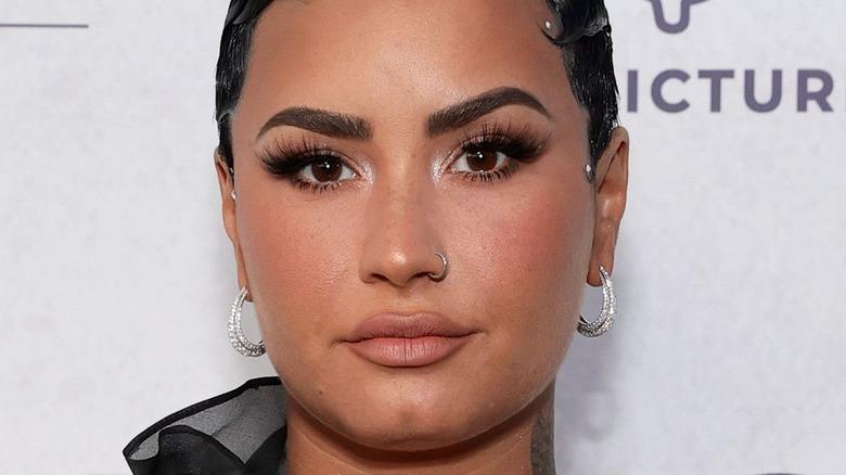 Demi Lovato posing at event