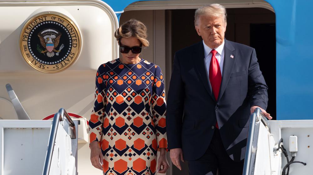 Melania and Donald descending airplane