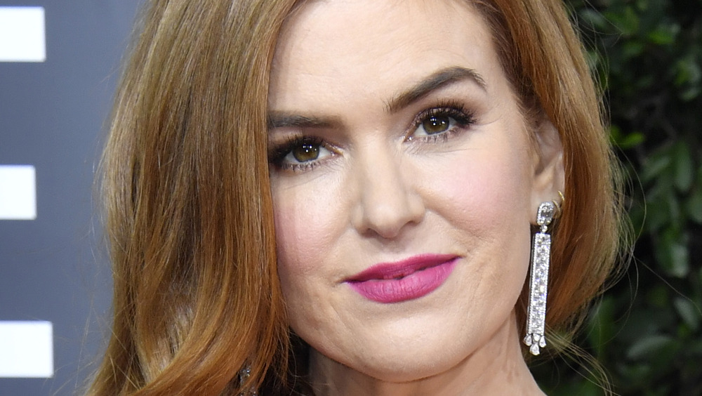 Isla Fisher grinning in pink lipstick
