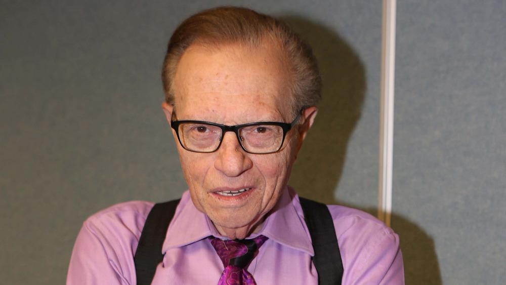 Larry King wears suspenders