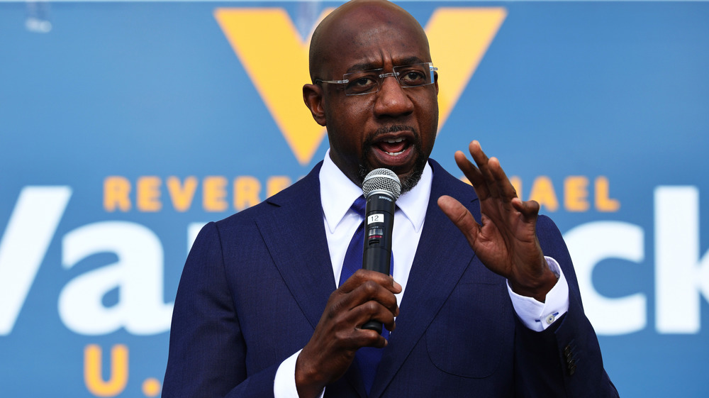 Raphael Warnock with a microphone