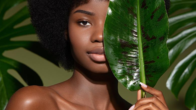 black woman natural leaf