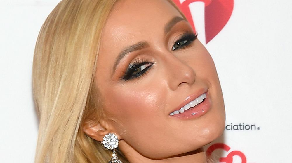 Paris Hilton smiling at event