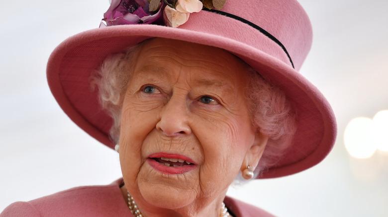 Queen Elizabeth looks away from the camera