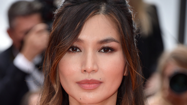 Gemma Chan poses on the red carpet