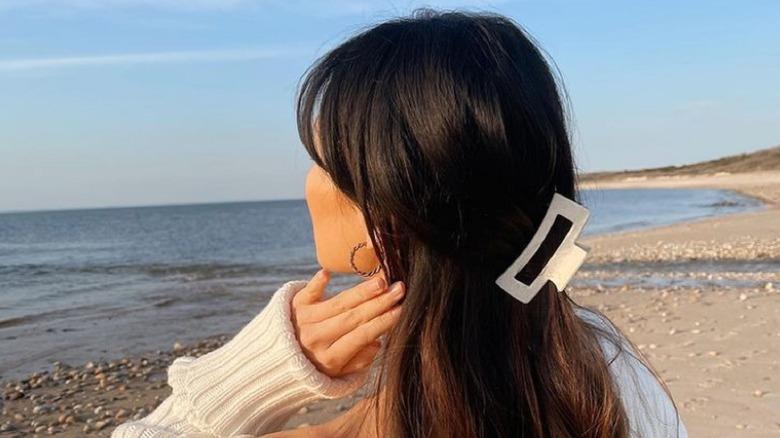 Girl wearing a claw hair clip