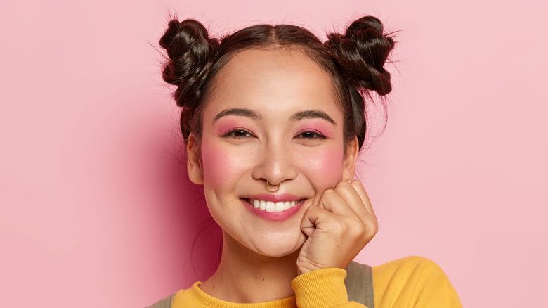cheerful woman wearing pink blush