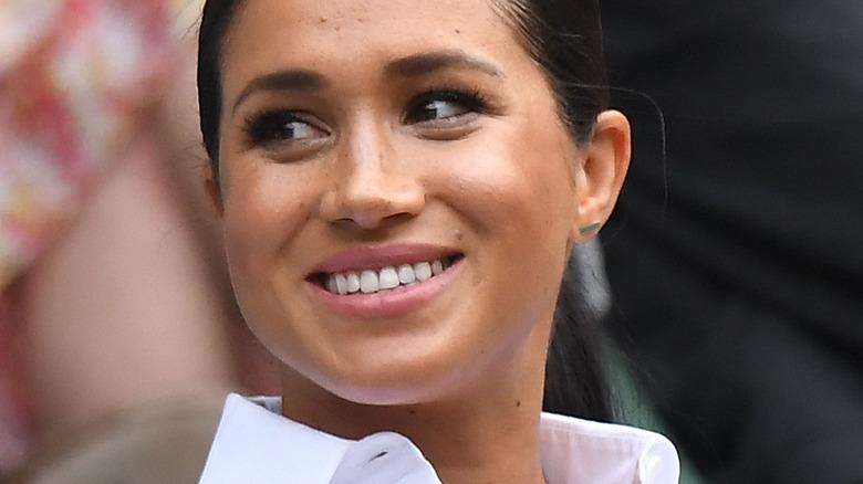 Meghan Markle in white shirt