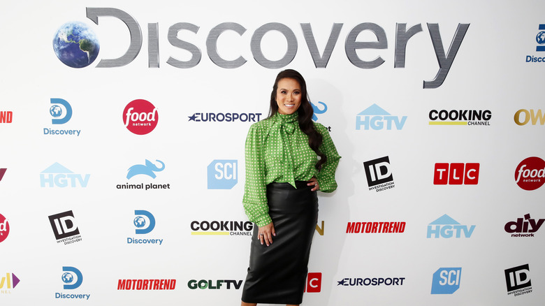 Dr. Pimple Popper in front of Discovery logo and all the network's brands