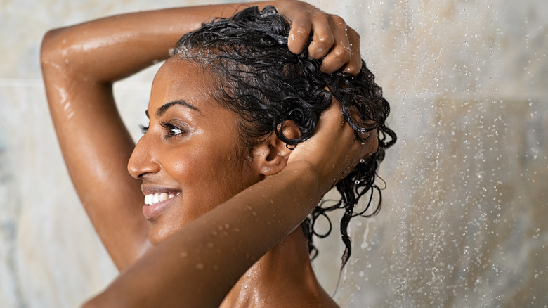 Woman shampooing her hair in the shower