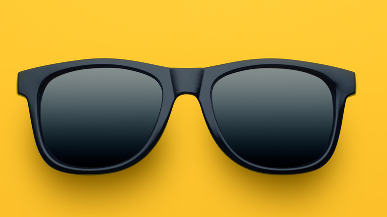 black sunglasses on a yellow background