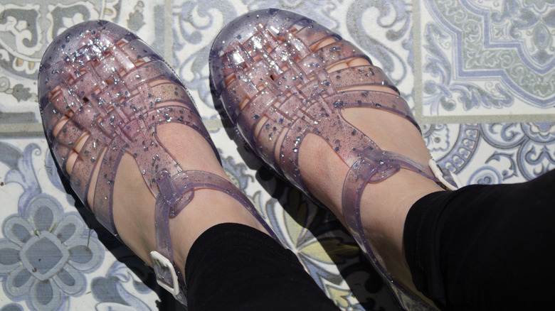 person wearing jelly shoes