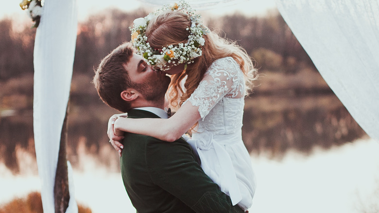 couple kissing on wedding day
