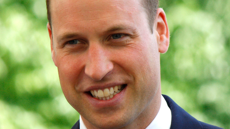 Prince William smiles at an event.