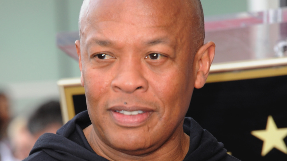 Dr. Dre looking serious at 50 Cent's Hollywood Walk of Fame ceremony