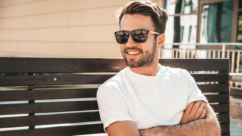 man smiling in sunglasses