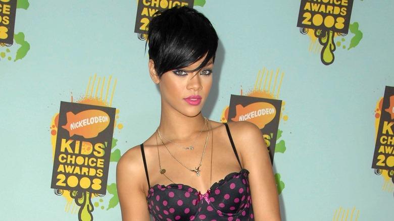 Rihanna posing in strappy top