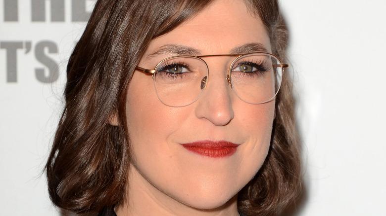 Mayim Bialik in glasses wearing red lipstick