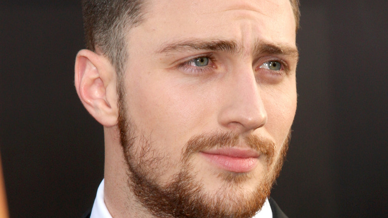 Aaron Taylor-Johnson posing at event