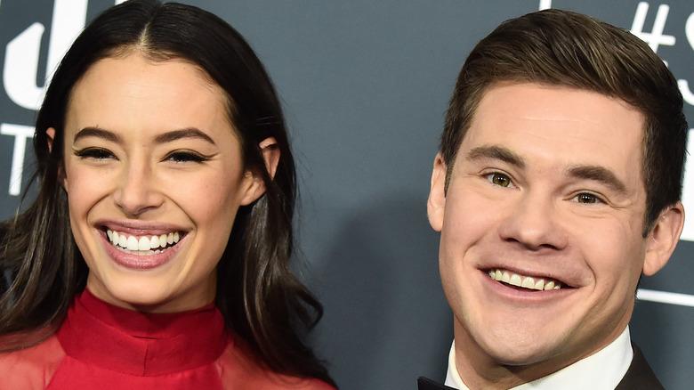 Chloe Bridgers and Adam DeVine smiling