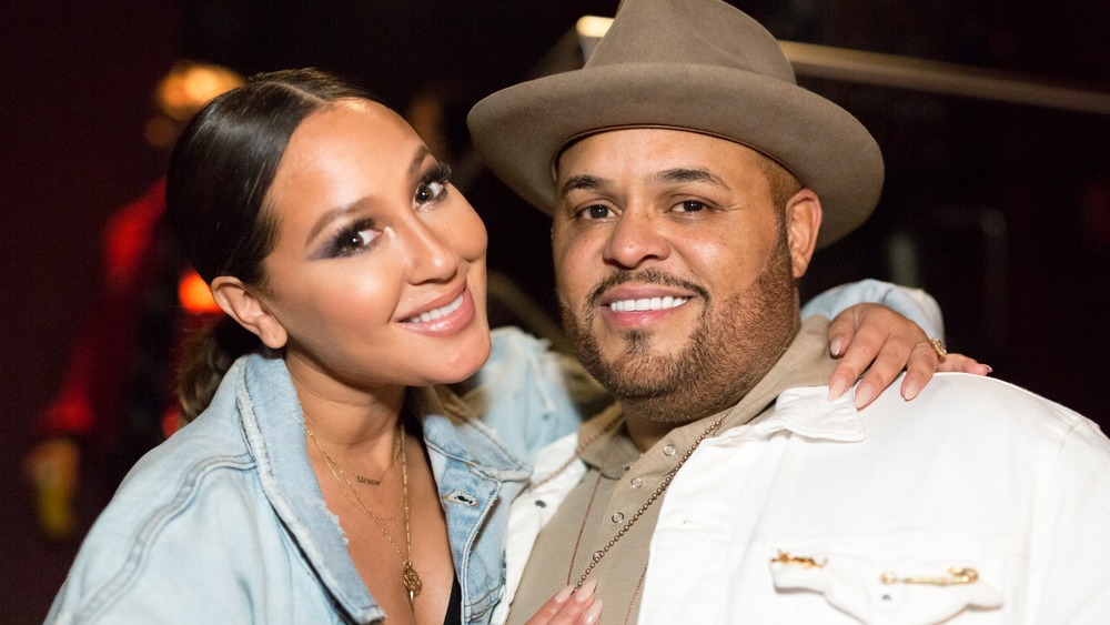 Adrienne Bailon and Israel Houghton hugging