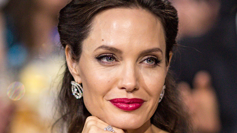 Angelina Jolie smiles at an event