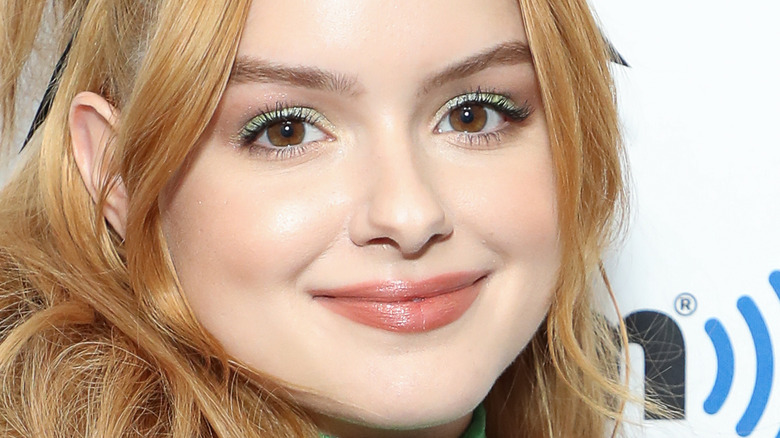 Ariel Winter smiling with green eye shadow
