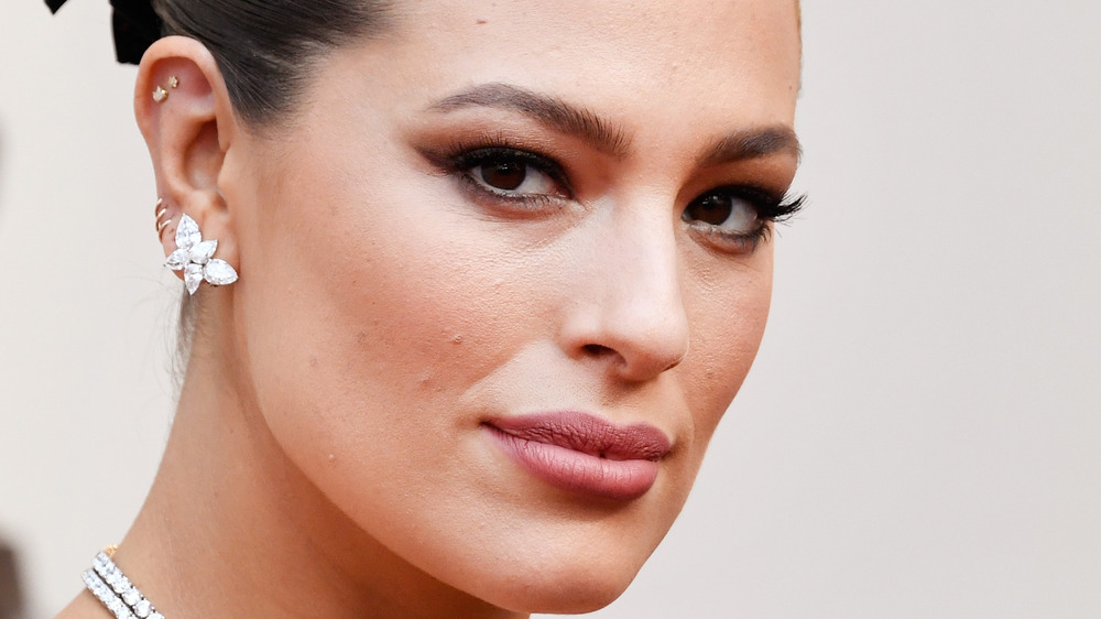 Ashley Graham posing with hair pulled back