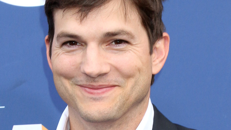 Ashton Kutcher smiling with mouth closed