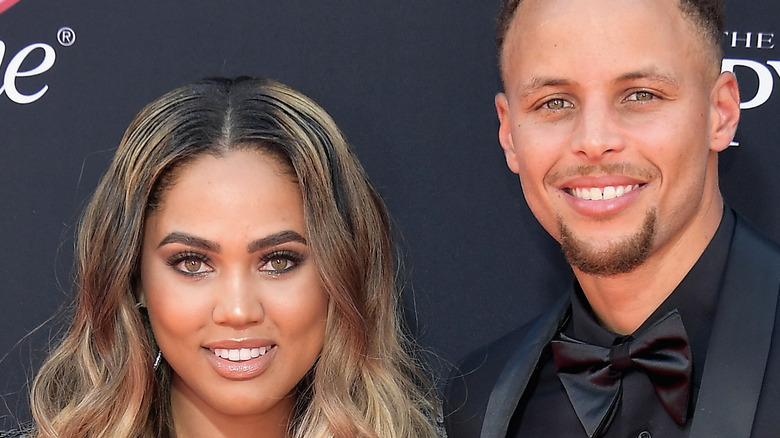 Ayesha Curry and Stephen Curry smile