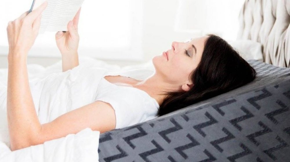 Woman using wedge pillow