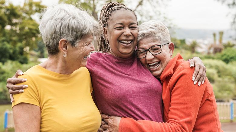 Three women embracing