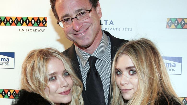 Bob Saget with the Olsen twins posing